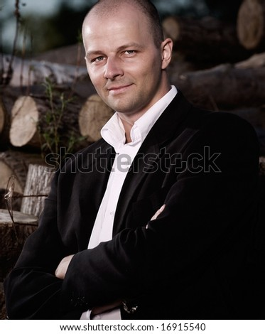 Confident standing portrait of a handsome man. - stock photo