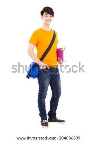confident student holding books and slanting knapsack - stock photo