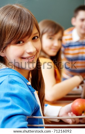 Confident student looking at camera during lesson