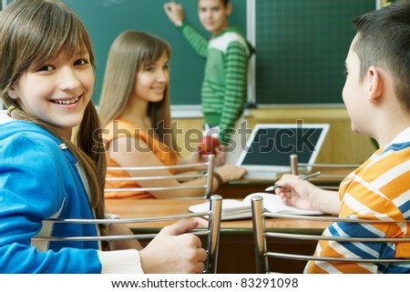 Confident student looking at camera during lesson - stock photo