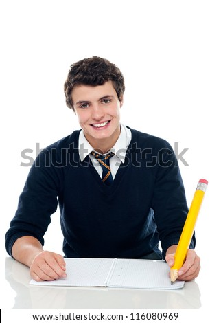 Confident student writing down notes. Isolated against white background - stock photo