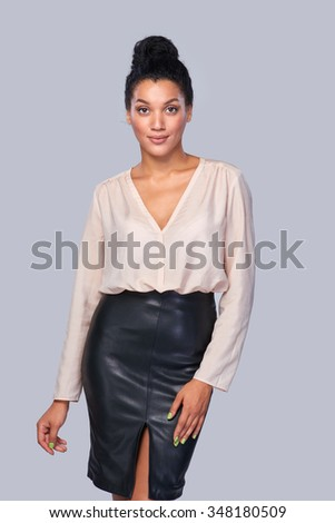 Confident successful mixed race caucasian - african american business woman standing smiling at camera - stock photo