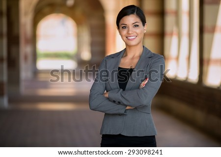 Confident successful smiling business woman executive with folded arms  - stock photo