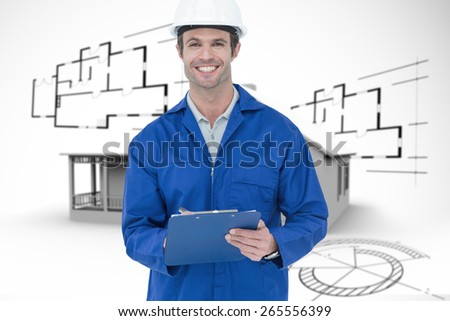 Confident supervisor writing notes against house in grey with architect plans - stock photo