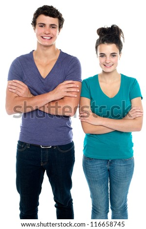 Confident teen with their arms crossed isolated against white background - stock photo