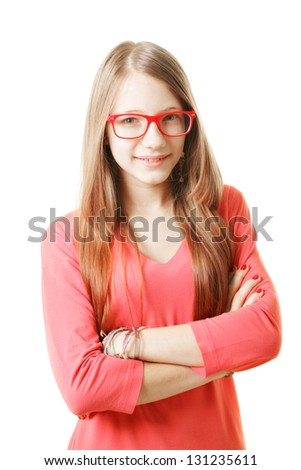 Confident teenage girl in red sweater arms folded
