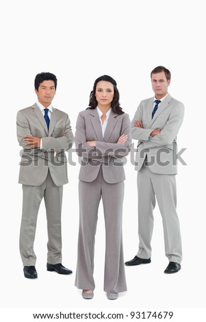 Confident tradesteam with arms folded against a white background