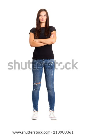 Confident unhappy woman with crossed or folded arms.  Full body length isolated over white. - stock photo