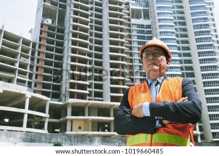 Confident Vietnamese contractor at the construction site