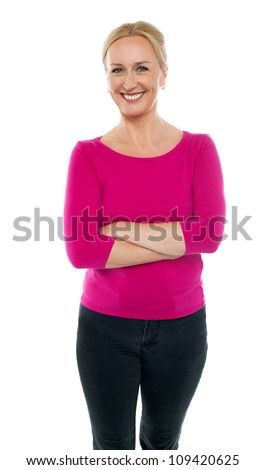 Confident woman dressed in casual wear standing with arms crossed