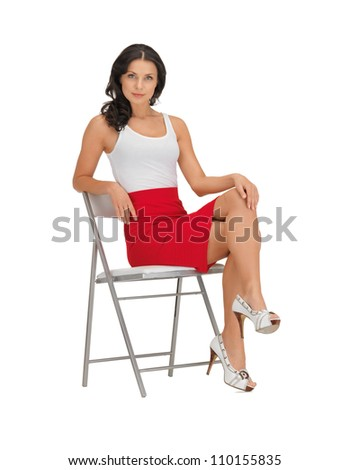 confident woman in blank white t-shirt on a chair - stock photo