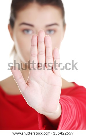 Confident woman making stop gesture sing with hand  - stock photo