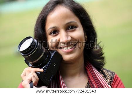 Confident woman photographer - stock photo