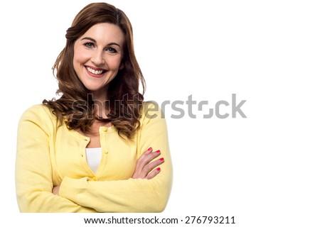 Confident woman posing casually to camera - stock photo