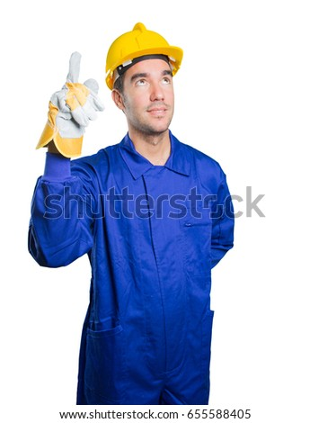 Confident workman pointing up on white background