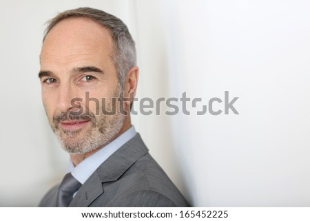 Confident 50-year-old businessman - stock photo