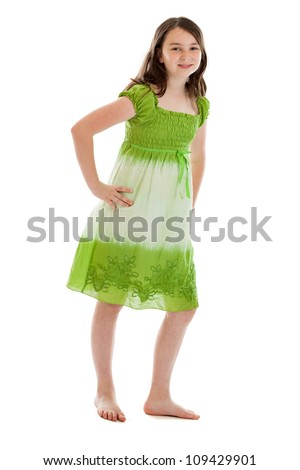 Confident 10 year old girl full length portrait isolated on white background - stock photo