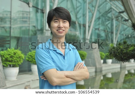 confident young asian businessman - stock photo