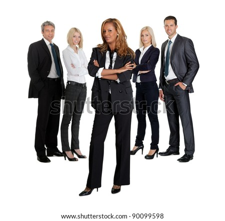 Confident young business executive with her team in the background on white - stock photo