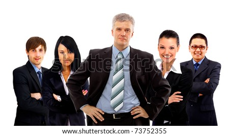 Confident young business executive with his team in the background - stock photo