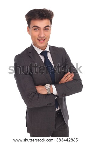 confident young business man smiling with hands crossed isolated on white background
