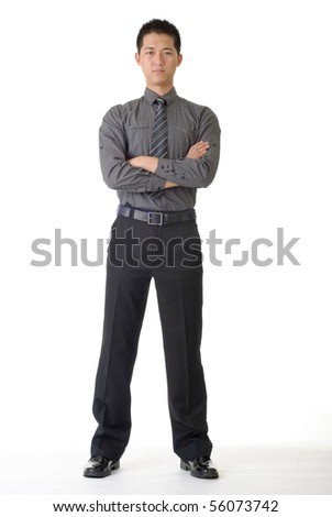 Confident young business man standing and looking, full length portrait on white. - stock photo