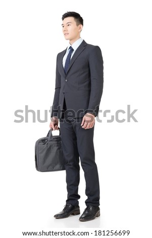 Confident young business man with briefcase, full length portrait isolated on white background.