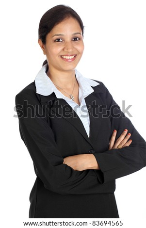 Confident young business woman against white background