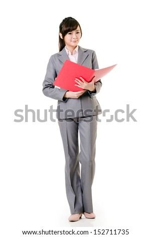 Confident young business woman of Asian, full length portrait on white background.