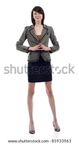 Confident young business woman standing isolated over white background - stock photo