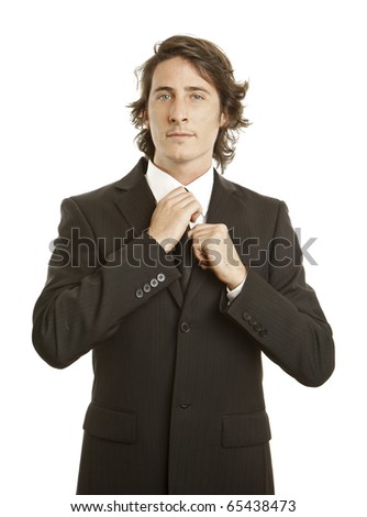 confident young businessman against white background - stock photo