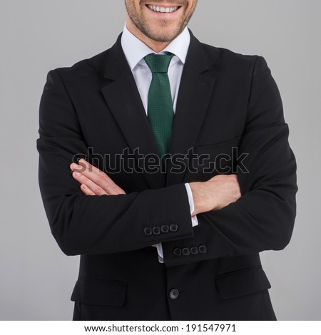 Confident Young Businessman. Close up image of businessman posing confidently with his arms crossed.  - stock photo