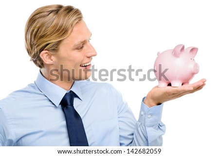 Confident young businessman holding piggybank is successful isolated  on white background - stock photo