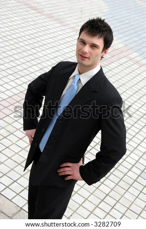 Confident young businessman in a suit and tie - stock photo