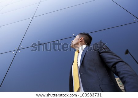 Confident young businessman next to his office building