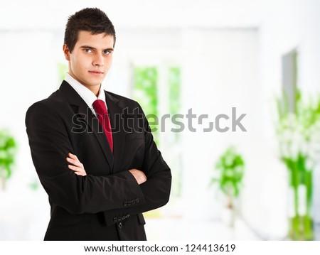 Confident young businessman portrait - stock photo