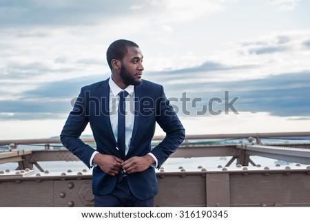 Confident young businessman portrait on Brooklyn Bridge. New York City. - stock photo