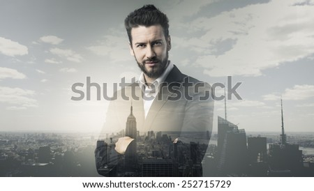 Confident young businessman posing with cityscape on background - stock photo