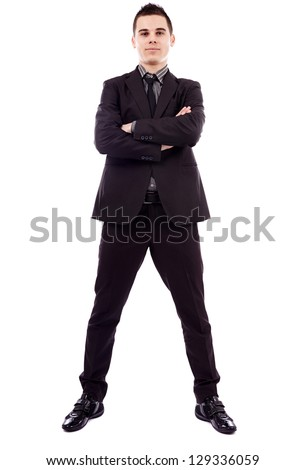 Confident young businessman standing with his arms crossed in full length pose, isolated on white background, business concept