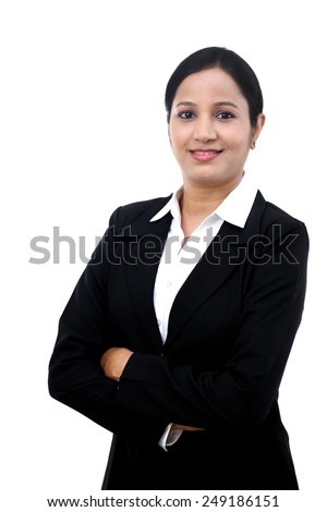 Confident young businesswoman against white background - stock photo