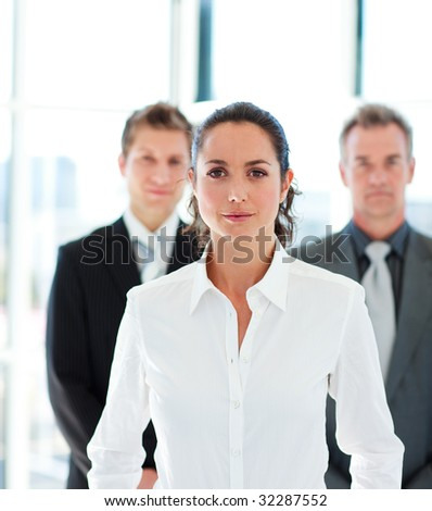 Confident young businesswoman leading her team - stock photo