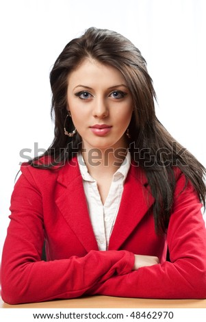 Confident young businesswoman sitting at her desk