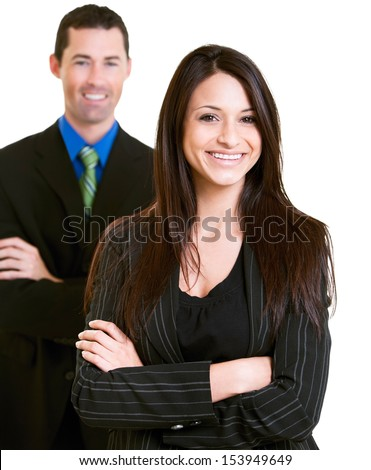 Confident young businesswoman with male colleague over white background - stock photo