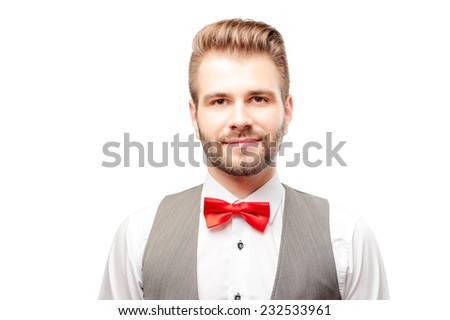 Confident young caucasian man in red bow tie isolated on white background - stock photo