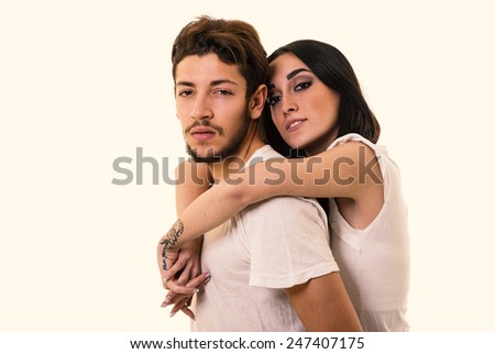 Confident young couple close up studio portrait in a romantic mood. Filtered image. - stock photo