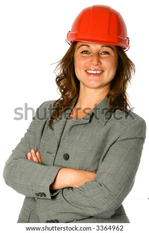 Confident young female architect in smart suit and red safety helmet, isolated on white. - stock photo