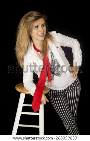 Confident young female leaning on  bar stool - stock photo