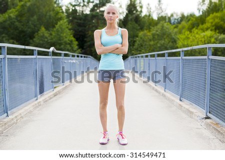 Confident young female runner having break after workout - stock photo