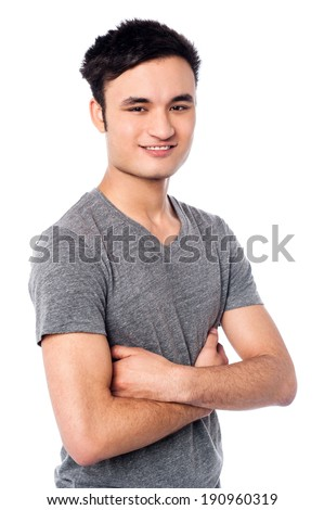 Confident young guy with arms crossed