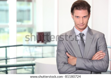 Confident young male executive - stock photo